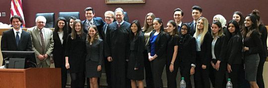 The Goshen High School Mock Trial team with their coaches after winning the Regional competition.