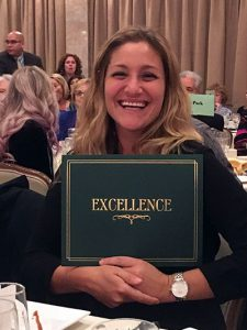 Kerry Eschabacher holds her Award for Excellence presented at the MHSSC awards dinner.