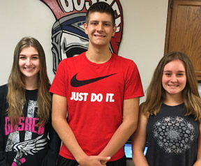 Cassidy Lucas, Brandon Fuentes and Olivia Klugman smile for the camera.