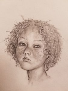 Drawing of curly haired girl.