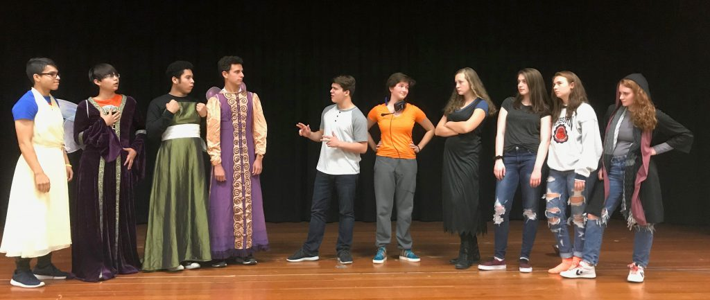 Students on stage in costume.