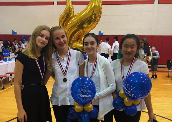 Four girls with National Junior Honor Society balloonss