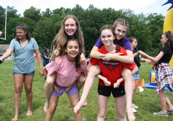 Middle school students enjoy field day activities.