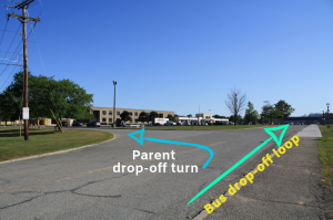 View of the high school roadways with arrows pointing to the parents and bus drop off