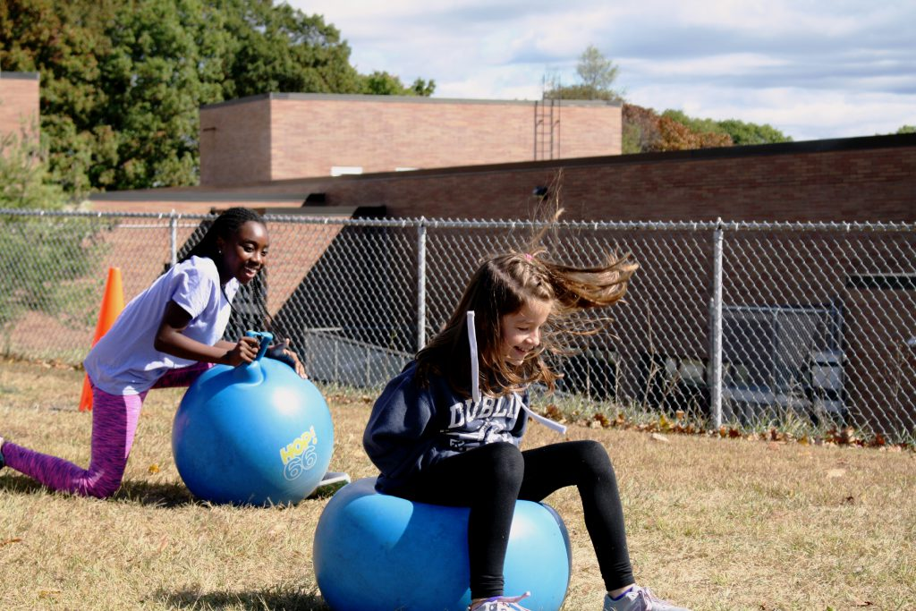 students jumping on hopper balls