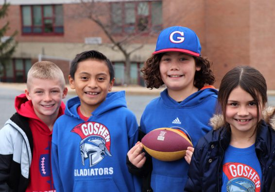 Four students in Gladiators gear