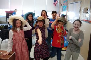 Students in costume striking a pose