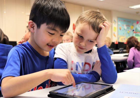 Two students working on a Chromebook