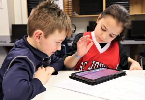 Two students work on their Chromebooks