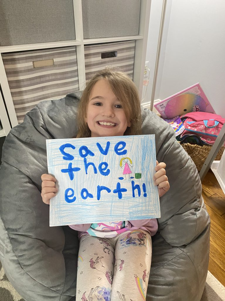 Child smiling and sitting in bean bag chair