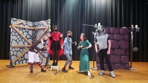 Students on stage wearing costumes