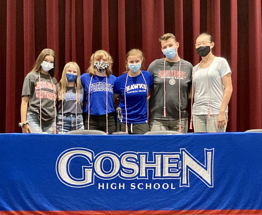 Photo of six teens in college t-shirts wearing face masks